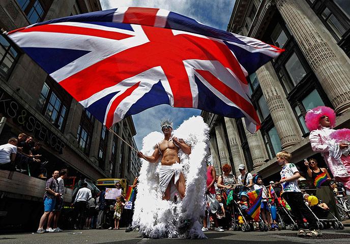 A participant waves a Union flag
