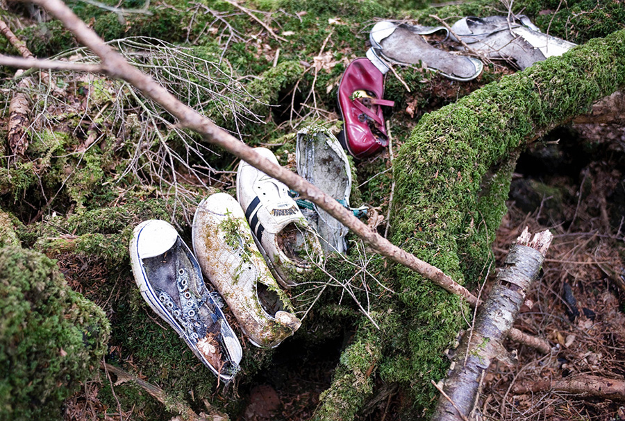 Four pairs of shoes lie in the undergrowth at Aokigahara Jukai, better known as the Mount Fuji suicide forest, which is located at the base of Japan's famed mountain in Yamanashi Prefecture, Japan on 26 March 2009. Suicide numbers in Japan have exceeded 30,000 for the past 12 years.