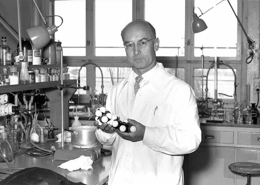 Albert Hofmann holding an LSD molecule model
