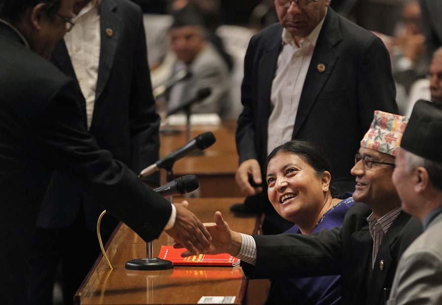 Bidhya Devi Bhandari, center, of the Communist Party of Nepal Unified Marxist-Leninist smiles after she was elected as Nepal's new president in Kathmandu, Nepal, Wednesday, Oct. 28, 2015. Bhandari, 54, who has long campaigned for women's rights was elected Wednesday as Nepal's first female president. (AP Photo/Niranjan Shrestha)