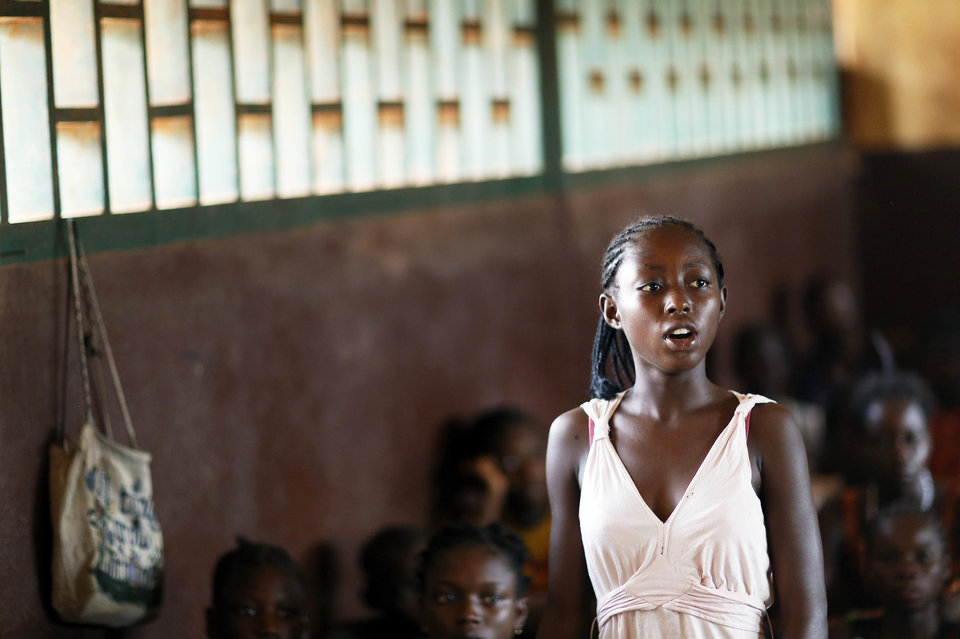 BANGUI, CENTRAL AFRICAN REPUBLIC - MARCH 12: A student standing and the rest of the students sitting in a classroom at a school the capital city of Bangui, Central African Republic as seen on March 12, 2014. (Photo by Thomas Koehler/Photothek via Getty Images)