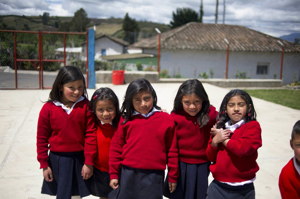 Girls pose at a rural school at La Palizada in Tulcan, Carchi province, in Ecuador close to the Colombian border on November 7, 2012. AFP PHOTO/Eitan Abramovich (Photo credit should read EITAN ABRAMOVICH/AFP/Getty Images)