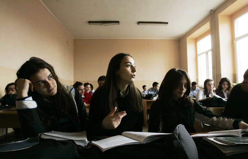 PRISTINA, SERBIA - MARCH 15: A Kosovo Albanian girl answers a question in a sociology class at Sami Frasheri high school March 15, 2007 in Pristina, Serbia. Young people under 25-years-old represent 60 per cent of the population of Kosovo, one of the highest percentages of youth in Europe. Residents of Kosovo are anxiously awaiting moves this year to formalize independence from Serbia, a move backed by nearly all ethnic Albanians in the Serbian province. Sami Frasheri was a leading Albanian poet in the 19th century. (Photo by Chris Hondros/Getty Images)