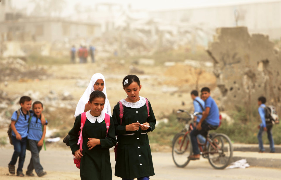 Palestinian school girls walk during a sandstorm in Gaza City on September 9, 2015. A dense sandstorm engulfing parts of the Middle East left at least eight people dead and hundreds suffering from respiratory problems, as officials warned residents to stay indoors. AFP PHOTO / MAHMUD HAMS (Photo credit should read MAHMUD HAMS/AFP/Getty Images)