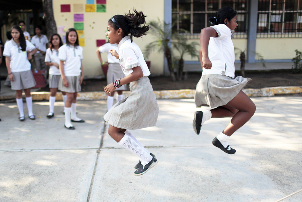 Children play during a break after returning to school following a two-months strike of teachers due to criminal threats, in Acapulco, Mexico, on January 27, 2015. AFP PHOTO/PEDRO PARDO (Photo credit should read Pedro PARDO/AFP/Getty Images)