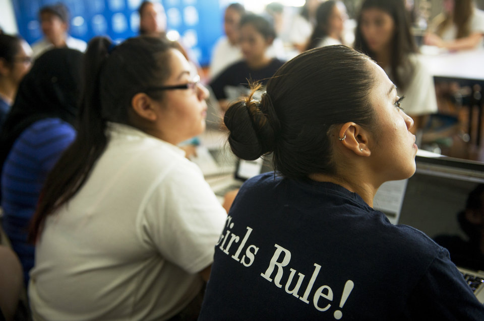 ASTORIA, NY - September 17: Students listen to instructions during a coding class at The Young Women's Leadership School of Astoria on September 17, 2015, in Astoria, New York. The all-girls STEM-focused public school was established in 2006. (Photo by Ann Hermes/The Christian Science Monitor via Getty Images)