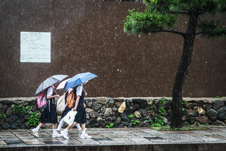 [UNVERIFIED CONTENT] Student girls are going to school under the rain. June 2013, Kyoto, Japan.