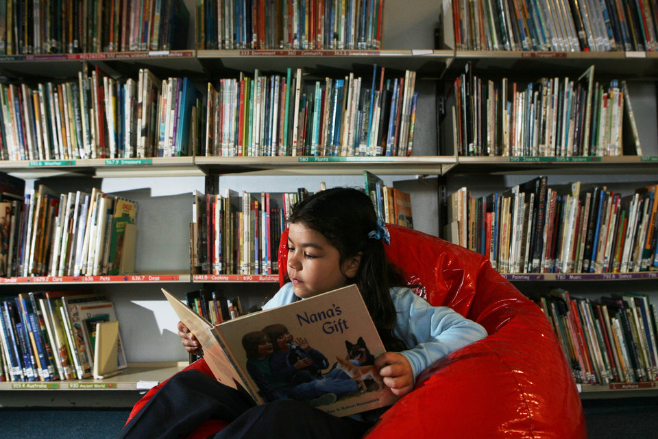 (AUSTRALIA & NEW ZEALAND OUT) Raeychale Cloutman, 6, from Malabar Public School, reads on a beanbag at her school, 19 July 2006. SHD Picture by ANTHONY JOHNSON (Photo by Fairfax Media via Getty Images)