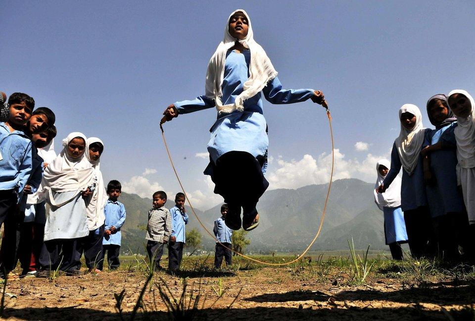 SRINAGAR, INDIA - AUGUST 11: Kashmiri school girls playing during recess in Kulhama district, Bandipora on August 11, 2015 in Srinagar, India. (Photo by Waseem Andrabi/Hindustan Times via Getty Images)