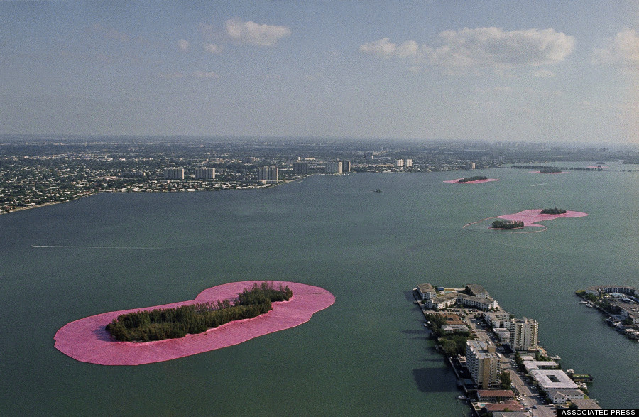 "Christo's ""Surrounded Islands"" take on the appearance of giant Lilly pads as the 3.1 million dollar art project in Biscayne Bay in Miami, May 7, 1983. The skyline of downtown Miami is in the background. (AP Photo/Pete Wright)"