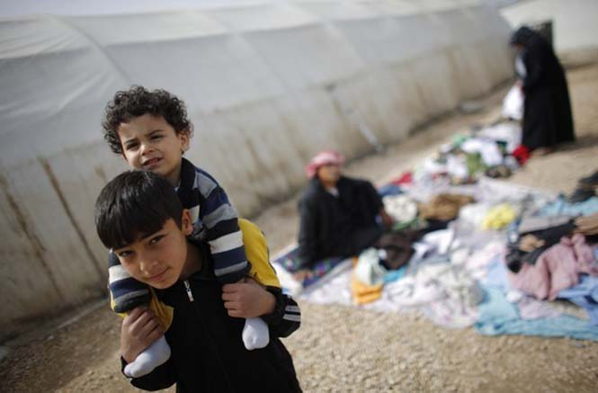 Gaziantep'teki Nizip mülteci kapımda Suriyeli bir çocuk. Fotoğraf: Murat Sezer/Reuters