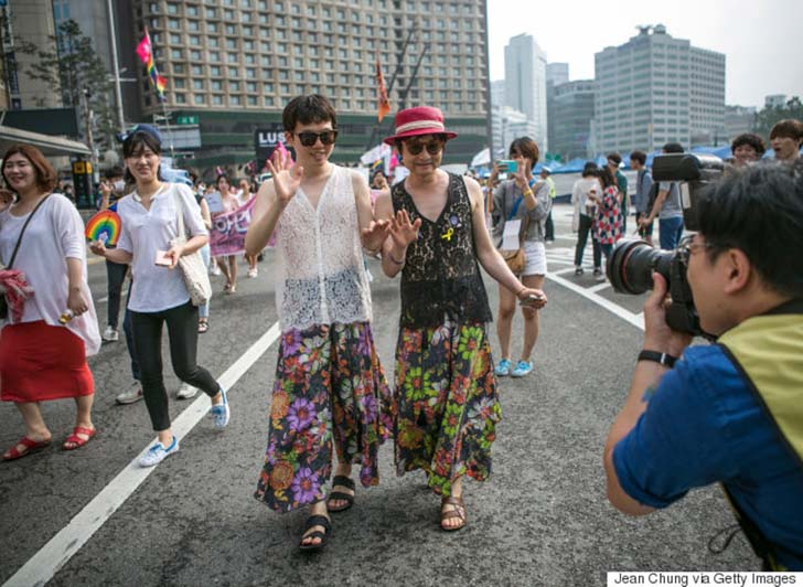 SEOUL, SOUTH KOREA - JUNE 11: (SOUTH KOREA OUT) Kim Seung-Hwan (L) and his partner, Kim Jho Gwang-Soo (R) pose for a photographer as they participate in a march during the Queer Festival on June 11, 2016 in Seoul, South Korea. While the homosexuality is legal in South Korea, same-sex marriage is not recognised. In May 25, 2016, The Seoul Western District Court rejected a lawsuit filed by a film director Kim Jho Gwang-Soo and his long-time partner, Kim Seung-Hwan, seeking legal status for their same-sex marriage, which they celebrated in a wedding in 2013. The couple announced that they would appeal the rejection to legally recognize their marriage. (Photo by Jean Chung/Getty Images)